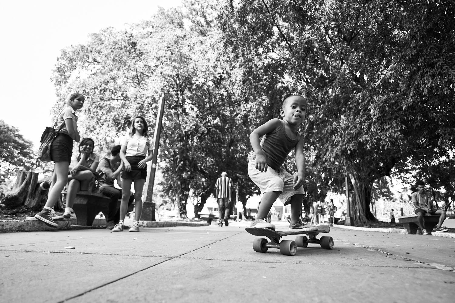 Photograph of young boy riding a skateboard at Parque Acapulco